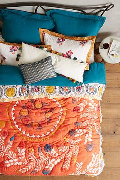Spotted at Anthropologie: Bright colors such as this Tangerine quilt create a bohemian inspired bedroom with Blue Paisley sheets and pillows Paisley Sheets, Boho Bedding, Luxury Bedding, Floral Bedding, Bohemian Bedding Sets, Bohemian Quilt, Paisley Bedding, Teal Bedding, Neutral Bedding