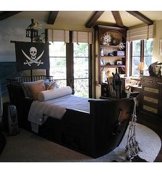 Pirate Ship Bed  ~ if he's still into pirates when he's older.  This is really cool.