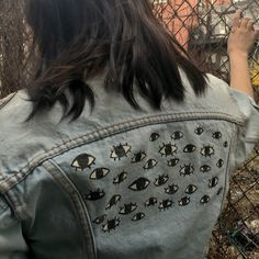 Vintage Crop Denim Jacket w/ Eye Print Back Amazing one of a kind cropped denim jacket from the 90's. On the back there is a hand painted eye pattern I made. It's been washed with the fabric paint on and it will not wear off. Pair with a cute dress or skirt. Can fits sizes Large and Small depending on fit. Model is a large. Vintage Jackets & Coats Jean Jackets