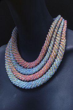 Elizabeth Tuttle, Four Layer Collar; Crocheted cotton sewing thread with glass beads. 1982 to 1990 #crochet #art #fineart #fiberart #fibreart #textile #textileart #domesticlife #domesticart #conceptualart #design #beadwork #beading #jewelery #wearableart Conceptual Art, Textile Art, Wearable Art, Fiber Art, Pattern Design, Jewelery, Glass Beads, Layers, Beaded Necklace