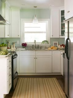 Cute little galley kitchen...a great way to make a little space pop and feel bigger.