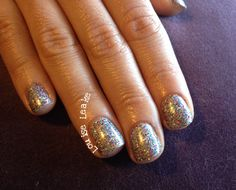 Holographic glitter and silver chrome shellac nails. By Louise Leake