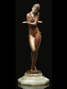 Coy Dancer.c.1920. Executed by Gustav Schmidtcassel. Cold-painted bronze, cold-painted ivory, green onyx plinth. Marked in the socle Schmidt-Kassel. 33 cm high. Source: Christies.  Ferdinand Preiss.(1882-1943). Schmidt-Kassel.(1867-1954).