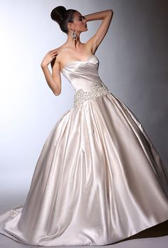 Brides: Victor Harper. Strapless satin ball gown with side draped bodice, dropped waist and embroidery at neck and hip line with front skirt applique.