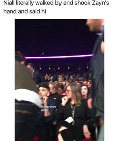 Zayn looks terrified and so caught off guard. He was in the middle of a conversation when Niall practically ran by on his way back to his seat during commercial break