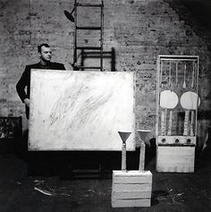 Cy Twombly in his Fulton Street Studio in 1954, photographed by Robert Rauschenberg.