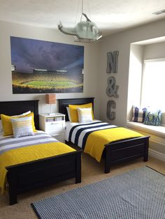 Beautiful bedroom with pops of yellow! University of Michigan children's room.