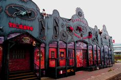 Haunted train station.  Love the body parts on the facade & the black & red accents.