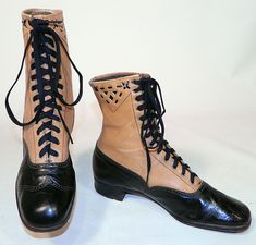 1910, Edwardian Black & Tan Two Tone Leather Lacing Cutouts High Top Boots Shoes The boots measure 8 inches tall, 10 inches long, 3 inches wide, with 1 inch high heels. These antique boots are difficult to size for today's foot but my guess would be about a size 7 narrow width.