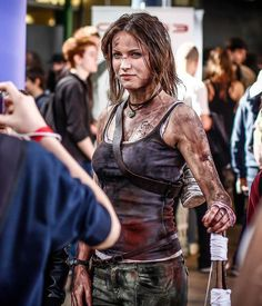 I really like the mud/blood/dirt on this chick. The hair not so much, but the rest of her outfit is awesome!