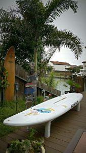 Repurposed surf board bench seat