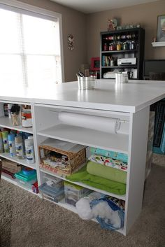"""Craft table: 80 x 60""""; 4 shelves from Walmart; 2 hollow core doors from Home Depot bracketed to solid end of shelves; paint."""