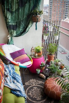 """""""In New York City, scoring an apartment with a balcony is like winning the lottery."""" The rainbow Acapulco chair is from Wayfair."""