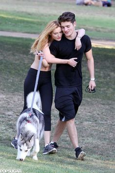 Bella and Gregg got playful with their pets at the park while the always-stylish actress wore only a sports bra and leggings. Check out more photos of the adorable couple.