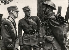 1941- Norway's King Haakon and Crown Prince Plav shown talking with a commander of a  Norwegian machine gun company stationed in Scotland.