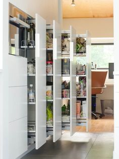 Choosing the right shelves will greatly help in your attempt to make your kitchen look more organized. These kinds of shelves with multiple levels is just perfect to stow away anything in your kitchen. Plus it's really stylish and modern.