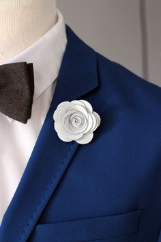 A personal favourite from my Etsy shop https://www.etsy.com/listing/226526171/white-lapel-rose-pin-mens-lapel-flower