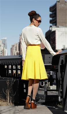 Yellow 1940s to 1950s box pleated skirt style