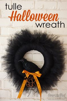 Easy tulle wreath for Halloween. Use a wreath form, tulle, and any random decorations you have to make a great wreath!
