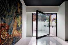 Cool door, and it looks like a cool indoor/outdoor space too.