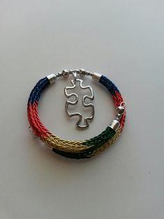 Autism Awareness Viking knit bracelet. Find it at: https://www.amazon.com/handmade/kydanjenjewelry