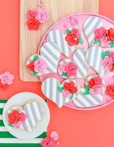 So simple! You won't believe just how easy these gorgeous striped fondant heart cookies with flowers are. Anybody can learn how to make them with this tutorial, promise!
