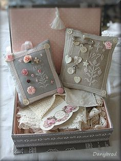 Lovely cross stitch pin cushions in pretty sewing box and lace wrapped around a pretty printed lace/thread holder. I have some pretty ones pinned on this board for you.