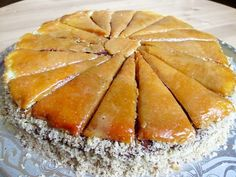 Dobos torte is the best and most famous Hungarian torte made of 6 paperthin sponge cake layers, filled with chocolate butter cream and topped with caramel slices.
