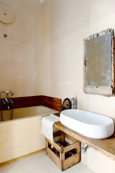 Basin on a wood board. A BEAUTIFUL FAMILY HOME IN THE SOUTH OF ITALY | THE STYLE FILES