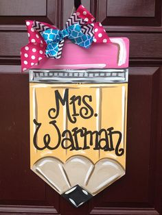 Do you have multiple teachers to buy for? Convo me for a price break on all 3! Cute pencil door hanger for that special teacher! Personalized with your teachers name for FREE! Measures 13 1/2 X 24 Multi colred ribbon bow Made of 1/4 plywood that is primed, painted and sealed with a