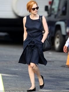 Jessica steps onto the set of The Disappearance of Eleanor Rigby in a tailored midnight blue dress pleated at the front.