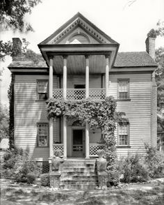 """The Thin Manse: Photo in 1936. Wilkinston-Dozier House. Built by Joshua Wilkinson between 1816 and 1826. This Federal style home with a double tiered portico was put on the National Register of Historic Places in 1974. County, North Carolina. """"J.F. Dozier Farm, Tarboro vicinity."""" 8x10 inch acetate negative by Frances Benjamin Johnston in 1936."""