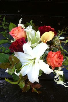 Dall color, celosia, lily, roses and orchids