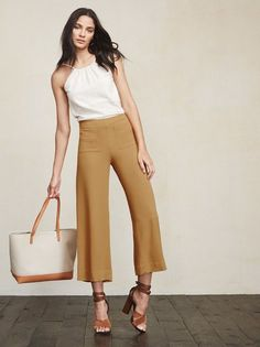 Alright, these guys make us wanna put on pants. The Selman Pant is a textured crepe pant with front pockets and a cropped wide leg. High waist, hidden zipper and hook/eye closure on the side. Made from surplus rayon blend.