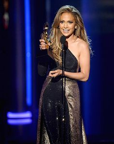 Jennifer Lopez looked gorgeous speaking onstage in a black and gold bodysuit at the 2014 Billboard Music Awards in Las Vegas on May 18