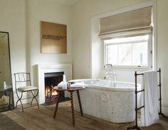 marble tub & fireplace | bathroom design by Rose Uniacke
