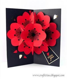 7 flowers pop-up card with nice red blossom~ ^w^ There are lots of templates available at the site.