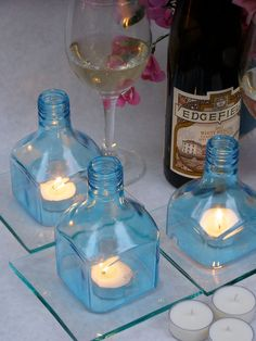 Blue and Cool Set of 3 Square Upcycled Bombay Saphire Gin Bottle Toppers with 6 Soy Votive Candles. $36.00, via Etsy.
