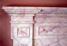 Faux pink marble fireplace