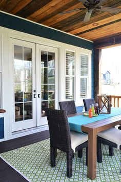 Raised back deck with french doors & a wood ceiling with dark blue exterior