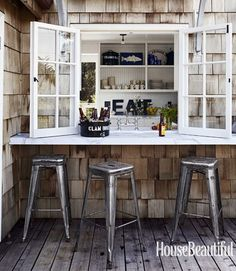 shingles siding. industrial bar stools. kitchen windows onto bar.  a lifes design: Cali Beach House...