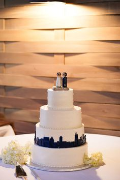 Hate the topper, but putting the skyline of the city you're moving to after the wedding would be a really great idea!