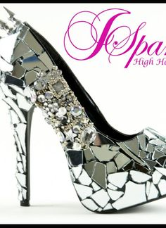 i dont normally like sparkles and rhinestones...but broken mirrors and spikes are ok by me :)