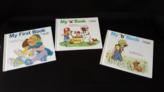 "Set of Three Hard Cover Illustrated Books. Titles Include: My First Book, My ""a"" Book, and My ""b"" Book. 