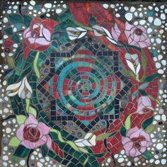 """""""The labyrinth project began in 2007 and was completed and installed at a private residence in Connecticut, USA, in October, 2010. The initial concept of a circuitous pathway has expanded into a yin/yang pattern of stepping stones leading in and out of a circular center courtyard."""" This is just one of 52 mosaic designs arranged in a labyrinth! Dar Mace Gabriola Studio"""