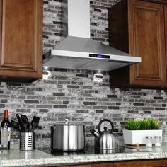 Update your home with this 30 inch stainless steel range hood. Help keep your kitchen free of smoke and grease featuring a removable, washable grease filter, this updraft range hood is wall mounted ab