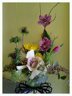 anemones, queen anne's lace, sunflowers, cymbidium orchids, manzanita branches, flowering kale, wax flower, seeded eucalyptus, hypericum berries, tulips, dianthus