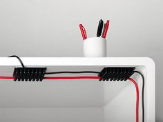 It should be pretty obvious that we're on an organize-your-workspace kick this week, and now it's time to tackle what is often the bane of a well-designed workspace: Cords!! From chargers to headphones to power cords and more, these electronic lifelines can be downright unruly. Here are 20 products and hacks that'll help you keep 'em in check.