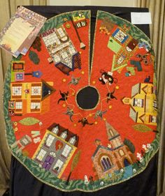 Stunning Christmas Tree Skirt - I think this would be cool if you could make your own appliquéd houses and sew them on so you could document each house you lived in as a family.