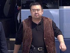 In this May 4, 2001, photo, a man believed to be Kim Jong Nam, right, the eldest son of then North Korean leader Kim Jong Il, walks out of a police van to board a plane to Beijing at Narita international airport in Narita, northeast of Tokyo. Kim was assassinated at an airport in Kuala Lumpur, telling medical workers before he died that he had been attacked with a chemical spray a Malaysian official said Tuesday. (Kyodo News via AP)